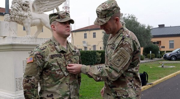 Sergeant Major of the Army Dan Daily promotes a junior enlisted soldier during a visit to U.S. Army Africa last fall. Dailey wants to eliminate sequence numbers for NCO promotions in a bid to make sure the best soldiers are promoted the quickest. (Staff Sgt. Lance Pounds/Army)