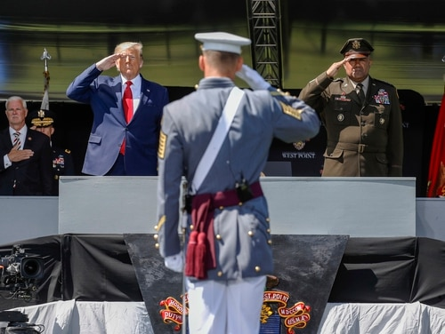 In this June 13, 2020, photo, President Donald Trump, left, and the United States Military Academy Superintendent Lt. Gen. Darryl A. Williams, right, salute graduating cadets as the national anthem is played during commencement ceremonies in West Point, N.Y. (John Minchillo/Pool via AP)