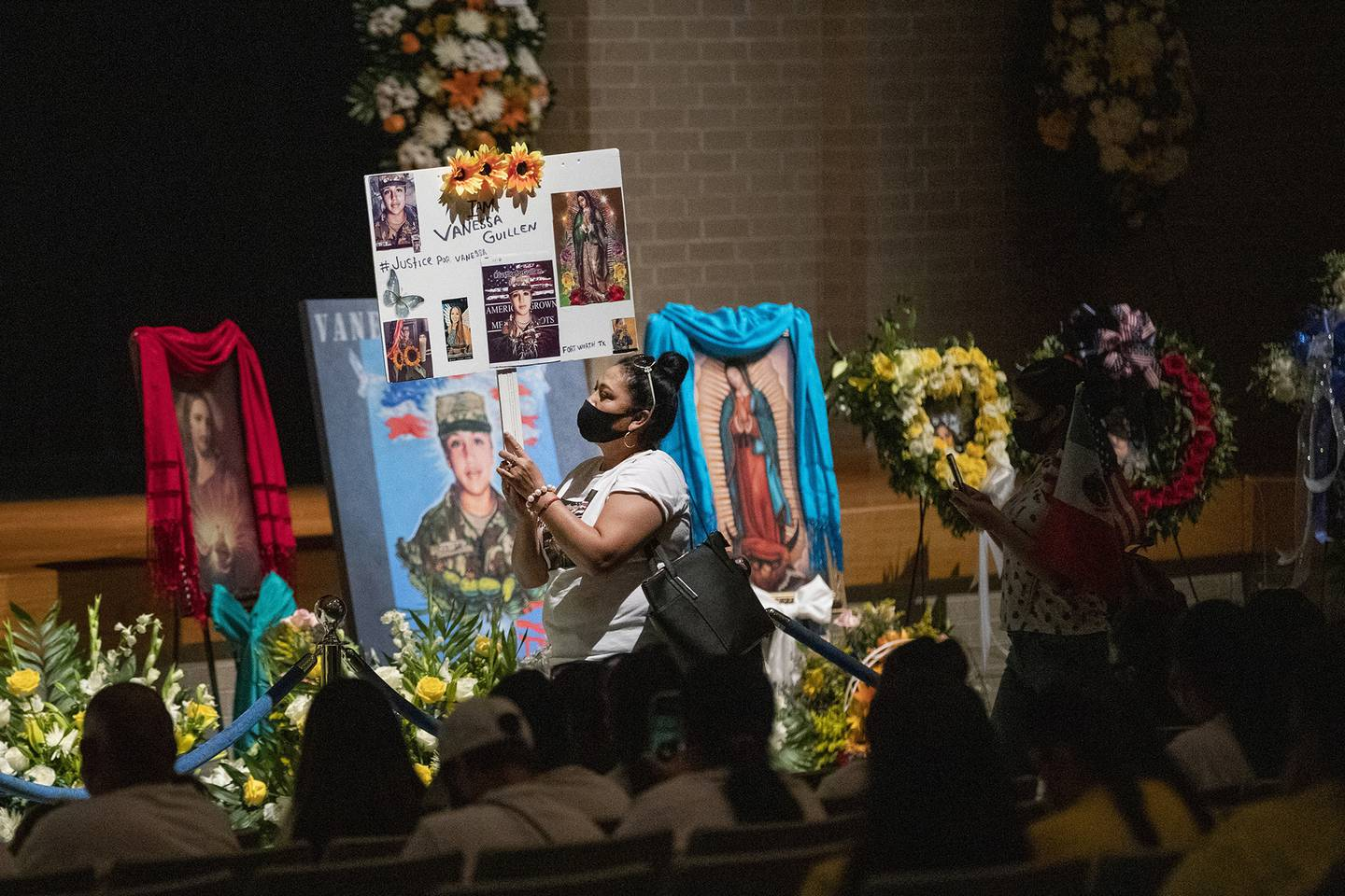 Rosa Samaniego holds a sign demanding justice for Spc. Vanessa Guillen at a memorial service in honor of the soldier on Friday, Aug. 14, 2020, in Houston.