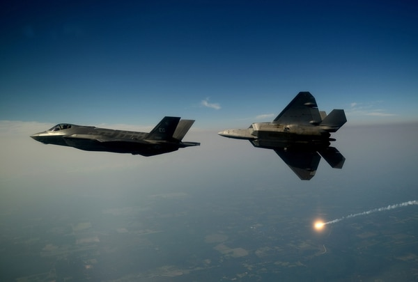 An F-35A and an F-22A Raptor fly together for the first time in 2012. (Master Sgt. Jeremy Lock/U.S. Air Force)