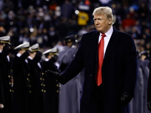 President Donald Trump crosses the field after the first half of the Army/Navy football game on Dec. 8, 2018, in Philadelphia. According to news reports, Trump will soon announce plans for a $750 billion defense budget in fiscal 2020. (Matt Rourke/AP)