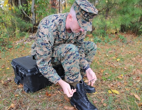 Capt. Caleb Haney, a project officer with the Program Manager for Infantry Combat Equipment at Marine Corps Systems Command, assembles the Marine Corps Intense Cold Weather Boot Nov. 13 aboard Marine Corps Base Quantico, Virginia. (Matt Gonzales/Marine Corps)