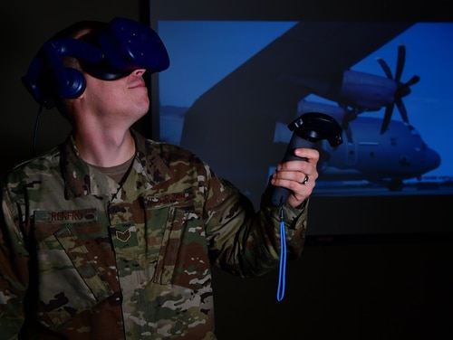 Staff Sgt. Kenneth Renfrow, a maintenance qualifications training instructor with the 19th Maintenance Group, uses a virtual reality headset at Little Rock Air Force Base, Ark., Dec. 19. (Airman 1st Class Aaron Irvin/Air Force)