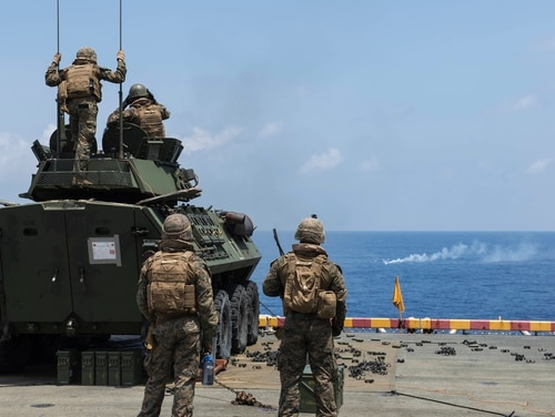 Marines assigned to the 31st Marine Expeditionary Unit (MEU), fire a Light Armored Vehicle's M242 Bushmaster 25 mm chain gun at a target during a Defense of the Amphibious Task Force drill aboard the amphibious assault ship USS Wasp (LHD 1).(Mass Communication Specialist 3rd Class Sean Galbreath/Navy)