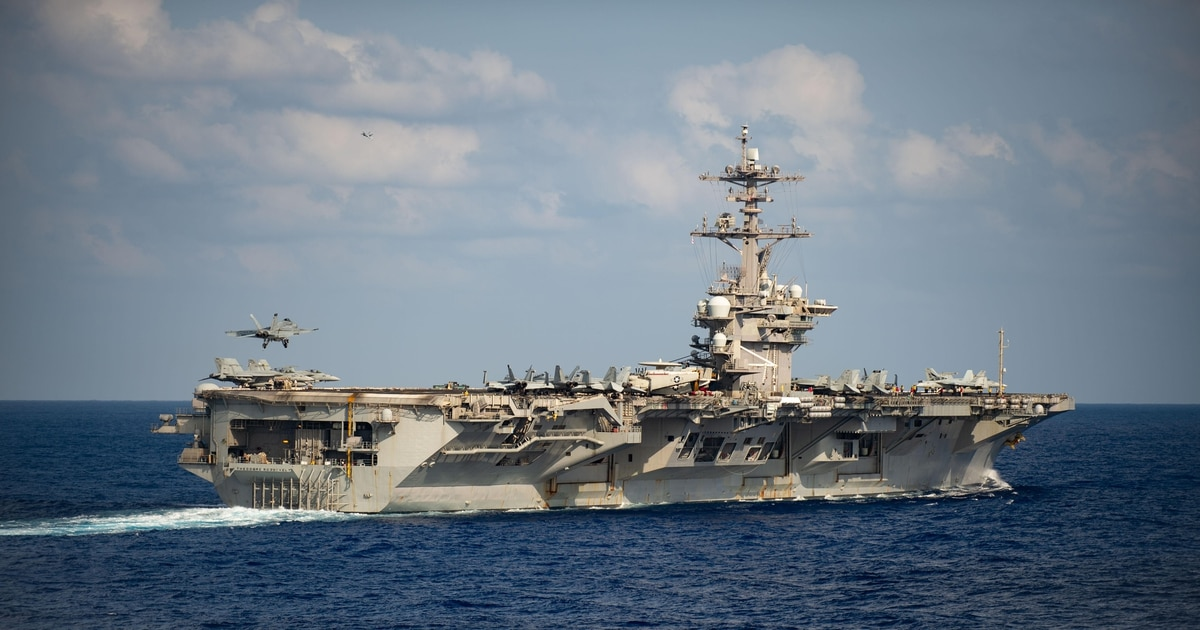 In the Pacific, a COVID-19 outbreak sidelines deployed aircraft carrier Theodore Roosevelt