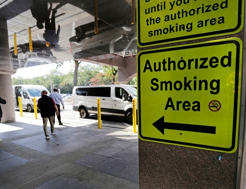 A sign directs patients and staff workers to a smoking shack outside the main entrance of the West Roxbury campus of the Veterans Affairs Medical Center in Boston, Monday, Sept. 30, 2019. (Charles Krupa/AP)