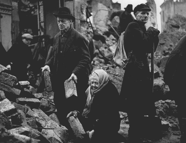 Two elderly Germans, Gustav and Alma Piltz, and other volunteers, clear rubble in preparation for the rebuilding of Dresden. (Fred Ramage/Getty Images)