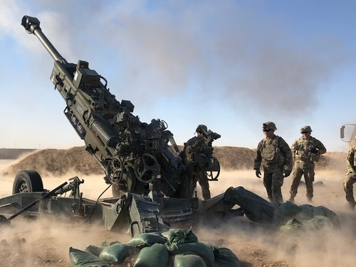 Troopers from the Field Artillery Support Squadron, 3rd Cavalry Regiment, support Iraqi army operations with artillery fires from their M777A2 Howitzers. (2nd Lt. Jamie Douglas/Army)