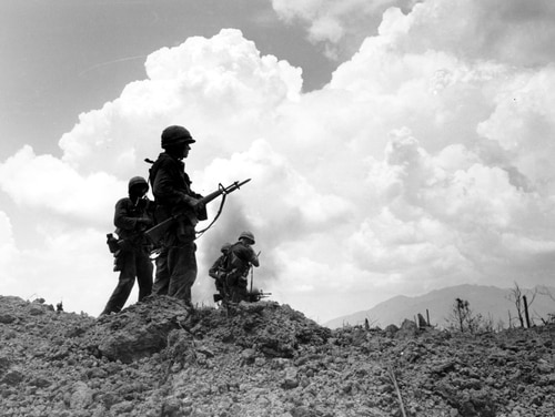 U.S. Marines are silhouetted as they stand on Hill 881 North after a fierce nine-day battle near Khe Sanh, Vietnam, on May 3, 1967, during the Vietnam War. (AP Photo)
