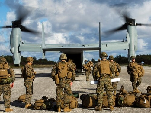An MV-22B Osprey disembarks Marines Dec. 9 at Baker runway on Tinian's North Field during Exercise Forager Fury II on Guam and within the Mariana Island Range Complex. (Lance Cpl. Antonio Rubio/Marine Corps)