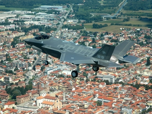 An F-35 combat aircraft made its first international flight, to great fanfare, over the Italian city of Galliate in 2015. With the arrival of a new government in 2018, the program has been on an uncertain path in Italy. (Lockheed Martin photo/Flickr)