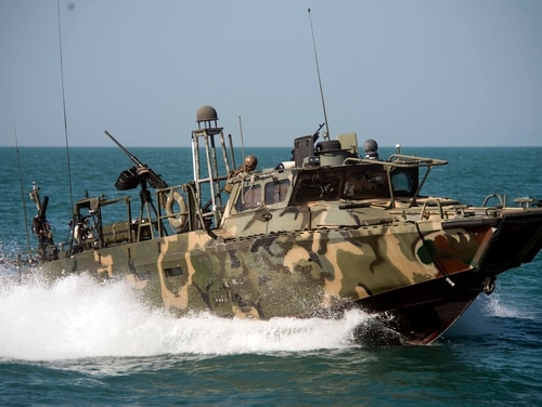 In this Oct. 26 2015, photo provided by the U.S. Navy, Riverine Command Boat (RCB) 802, assigned to Combined Task Group (CTG) 56.7, conducts patrol operations in the Persian Gulf. Weak leadership, poor judgment, a lack of