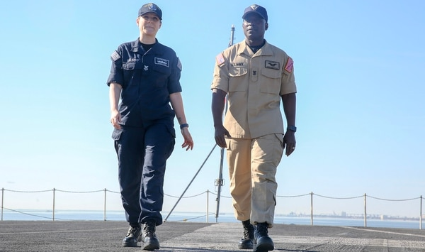 Yeoman 1st Class Kelly Pyron, U.S. Fleet Forces Command, and Force Master Chief Huben L. Phillips, Naval Air Force Atlantic, model the flame-resistant, two-piece organizational clothing prototype on board the aircraft carrier Harry S. Truman. The Navy will conduct a second wear test of the prototype later this year. (Mass Communication Specialist 2nd Class Stacy M. Atkins Ricks/Navy)