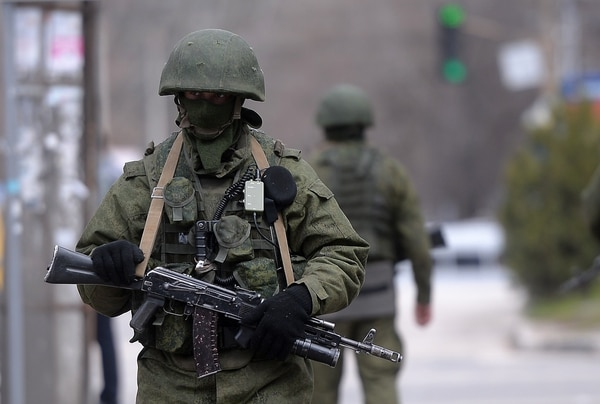 Russian soldiers patrol outside the naval headquarters in Simferopol, Ukraine, on March 19, 2014. (Filippo Monteforte/AFP via Getty Images)