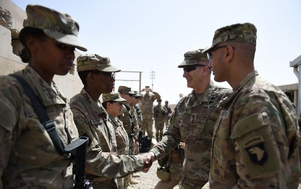 The US commander in Afghanistan John Nicholson (2R) shakes hands with US soldiers ahead of a handover ceremony at Leatherneck Camp in Lashkar Gah in the Afghan province of Helmand on April 29, 2017. US Marines returned to Afghanistan's volatile Helmand April 29, where American troops faced heated fighting until NATO's combat mission ended in 2014, as embattled Afghan security forces struggle to beat back the resurgent Taliban. The deployment of some 300 Marines to the poppy-growing southern province came one day after the militants announced the launch of their