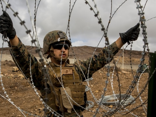 A Marine Corps combat engineer with 7th Engineer Support Battalion places concertina wire along the California-Mexico Border on Nov. 30, 2018. The House Armed Services Committee chairman on Thursday blasted Pentagon officials for withholding details of a planned troop increase along the southern U.S. border. (Lance Cpl. Brendan Mullin/Marine Corps)