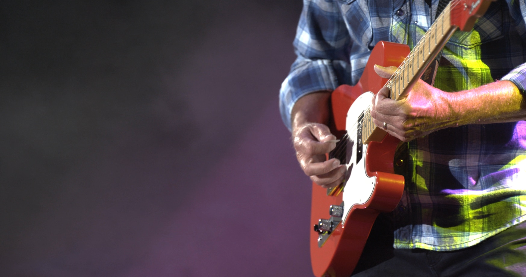 Fogerty plays during his