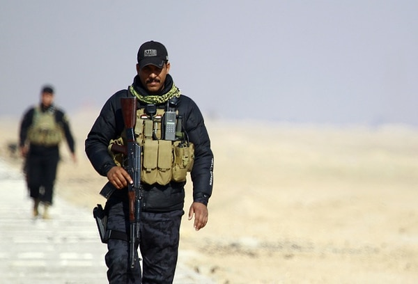 Members of the Iraqi security forces patrol the Najaf governorates border with the mostly Islamic State (IS) group controlled western province of Anbar as new security measures have been taken to beef up security on the border of the Saudi desert on January 24, 2015. IS spearheaded a major offensive in June that overran large areas north and west of Baghdad, including significant parts of Anbar. AFP PHOTO / HAIDAR HAMDANI (Photo credit should read HAIDAR HAMDANI/AFP/Getty Images)