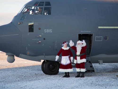 Mr. and Mrs. Santa Claus, traveling with Operation Santa Claus, alight from an HC-130J Combat King II with the 211th Rescue Squadron, Alaska Air National Guard, after landing in St. Michael, Alaska, on Dec. 5, 2017. Operation Santa Claus is an Alaska National Guard annual community outreach program that provides Christmas gifts, books, backpacks filled with school supplies, fresh fruit and sundaes to youngsters in rural communities. (2nd Lt. Marisa Lindsay/Army National Guard)