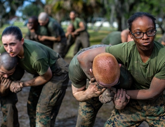 Recruits with India Company, 3rd Recruit Training Battalion, practice escaping headlocks during a Marine Corps Martial Arts Program training session Dec. 30, 2019, at Marine Corps Recruit Depot Parris Island, South Carolina. (Gunnery Sgt. Tyler Hlavac/Marine Corps)