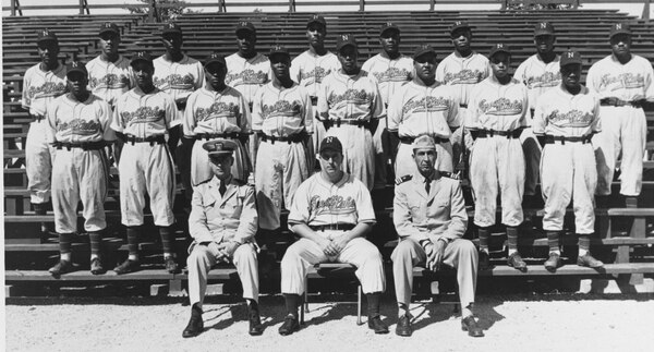 Before shipping out for the Pacific, in 1944 the future Baseball Hall of Fame athlete Larry Doby played for the Great Lakes African Americans varsity baseball team. (courtesy of Jerry Malloy, Naval History and Heritage Command)
