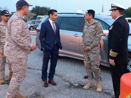 In this Dec. 9, 2019, photo made available by the FBI, Saudi Arabia Defense Attaché Maj. Gen. Fawaz Al Fawaz (second from right) meets with Saudi students at the NAS Pensacola base in Pensacola, Fla.(FBI via AP)