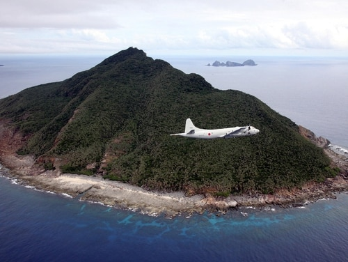 A Japanese P-3C patrol plane flies over the disputed islets known as the Senkaku islands in Japan and Diaoyu islands in China. (JAPAN POOL/AFP/Getty Images)