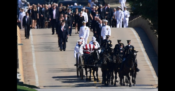 Family members, including Cindy McCain, back center, follow a horse-drawn caisson carries the casket of Sen. John McCain, R-Ariz., as it proceeds to the United States Naval Academy cemetery in Annapolis, Md., Sunday, Sept. 2, 2018, for burial. McCain died Aug. 25 from brain cancer at age 81. (Susan Walsh/AP)