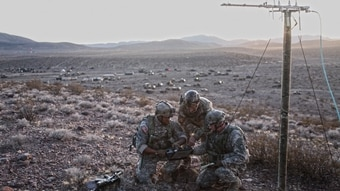 US. Army soldiers Sgt. Devon Cloud and Sgt. First Class Joseph Wambach, members of the 1st Stryker Brigade Combat Team, 25th Infantry Division Tactical Electronic Warfare Team, are accompanied by civilian contractor Don Behr as they use an integrated system of sensors to survey the electro-magnetic spectrum and identify frequencies of interest at the National Training Center on Fort Irwin, Calif., on Jan. 15, 2017. (Sgt. Michael Spandau/Army)