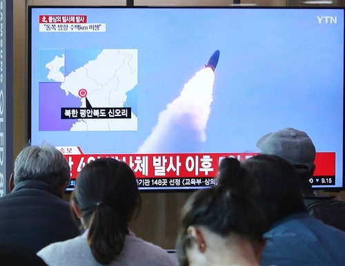 People watch a TV showing file footage of North Korea's missile launch during a news program at the Seoul Railway Station in Seoul, South Korea, Thursday, May 9, 2019. (Ahn Young-joon/AP)