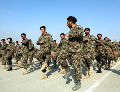 Newly graduated Afghan National Army march during their graduation ceremony after a three-month training program at the Afghan Military Academy in Kabul, Afghanistan. (AP Photo/Rahmat Gul)