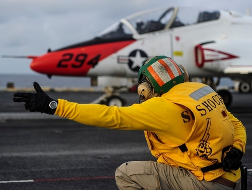 Lt. Jeffrey Knight, a shooter aboard the carrier George Washington gives the signal to launch a T-45C Goshawk. (U.S. Navy photo by MC3 Wyatt L. Anthony)
