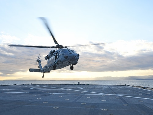 An MH-60S Sea Hawk helicopter from the Golden Falcons of Helicopter Sea Combat Squadron 12 launches from the flight deck of U.S. 7th Fleet flagship Blue Ridge on Tuesday in Sagami Bay. (Mass Communication Specialist 2nd Class Dylan McKay/Navy)