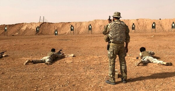 Members of the Maghawir al-Thawra Syrian opposition group receive firearms training from U.S. Army Special Forces soldiers at the al-Tanf military outpost in southern Syria on Monday, Oct. 22, 2018. (Lolita Baldor/AP)