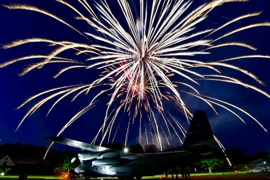 Fireworks light up the sky over a C-130H at Heritage Park to conclude the sixth annual Liberty Fest at Little Rock Air Force Base, Arkansas, July 2. (2nd Lt. Charles Rivezzo/Air Force)