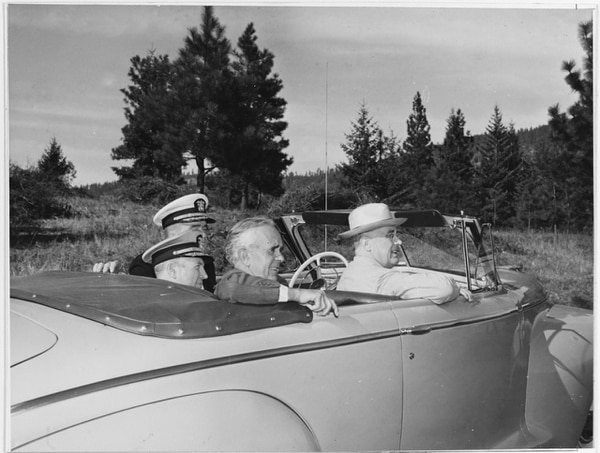 President Franklin D. Roosevelt, Idaho Gov. Chase A. Clark, Rear Adm. Ross McIntire (middle of back seat, the president's personal physician), and Capt. Ingram C. Sowell, commander of what was then the Farragut Naval Training Station, take in the scenery near Lake Pend Oreille, probably in 1942. Although Farragut shuttered in 1946, the Navy retained a presence on the lake with its Acoustic Research Detachment. (U.S. Naval History and Heritage Command)
