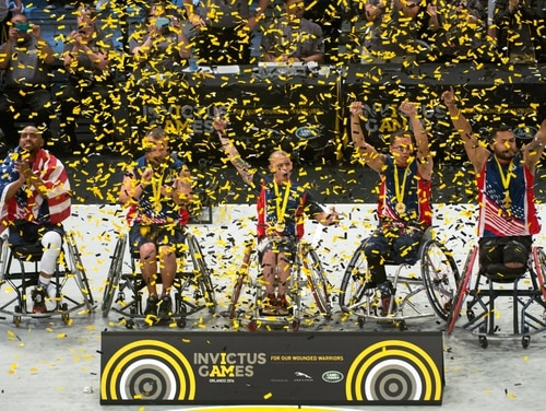 U.S. wheelchair basketball team members celebrate their gold medal win during the 2016 Invictus Games in Orlando, Fla., May 12, 2016. (DoD)