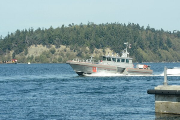 A Coast Guard 64-foot Special Purpose Craft-Screening Vessel from the Maritime Force Protection Unit in Bangor, Wash., is pictured crossing through the Hood Canal Bridge during exercise Northern Vindicator on Sept. 23, 2015. The SPC-SV, a Navy-owned vessel operated by Coast Guard crews, is used to escort submarines to and from Naval Base Kitsap-Bangor. (Coast Guard)