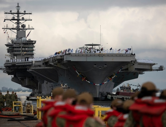 The carrier Dwight D. Eisenhower returns to Naval Station Norfolk after a Middle East deployment. (U.S. Navy)