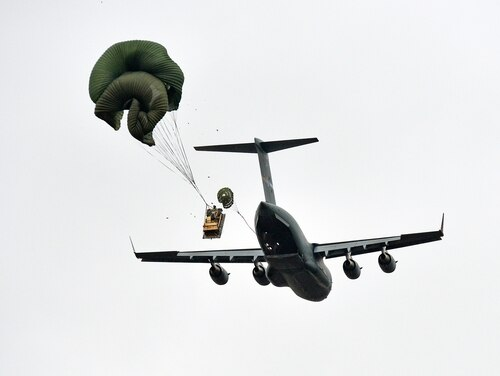 A C17 Globemaster III from Papa Air Base, Hungary, airdrops a over Pordenone, Italy, in October 2016 during Peacemaster Unity training. A C-17 from Joint Base Charleston accidentally airdropped a Humvee over a North Carolina neighborhood Wednesday, about five miles short of a drop zone near Fort Bragg. (Davide Dalla Massara/Army)
