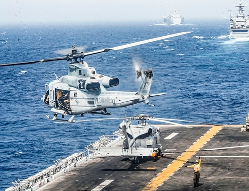 A UH-1Y Venom helicopter takes off from the flight deck of the amphibious assault ship USS Boxer (LHD 4) on July 18, 2019, during a Strait of Hormuz transit. (Lance Cpl. Dalton Swanbeck/Marine Corps)