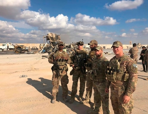 In this Jan. 13, 2020, file photo, U.S. soldiers stand at a site of Iranian bombing at Ain al-Asad air base in Anbar, Iraq. (Qassim Abdul-Zahra/AP)