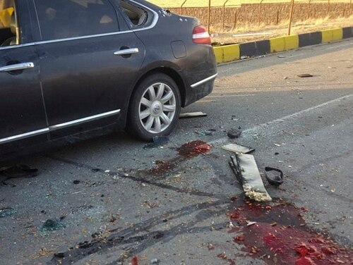 """This photo released by the semi-official Fars News Agency shows the scene where Mohsen Fakhrizadeh was killed in Absard, a small city just east of the capital, Tehran, Iran, Friday. Fakhrizadeh, an Iranian scientist that Israel alleged led the Islamic Republic's military nuclear program until its disbanding in the early 2000s was """"assassinated"""" Friday, state television said. (Fars News Agency via AP)"""