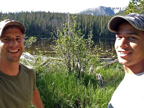 In this July 7, 2017, photo provided by Trevor Reilly, left, poses with Marine Pfc. Ali Al-kazahg while hiking in the Eagles Nest Wilderness of the Dillon Ranger District in Colorado. (Trevor Reilly via AP)