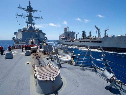 The destroyer Kidd, seen here during a replenishment at sea, had 47 confirmed cases of COVID-19 as of April 27. (MC3 Brandie Nuzzi/Navy)