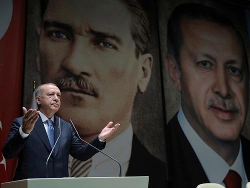 Turkey's President Recep Tayyip Erdogan addresses his ruling party members in Ankara on July 26, 2019. (Presidential Press Service via AP, Pool)