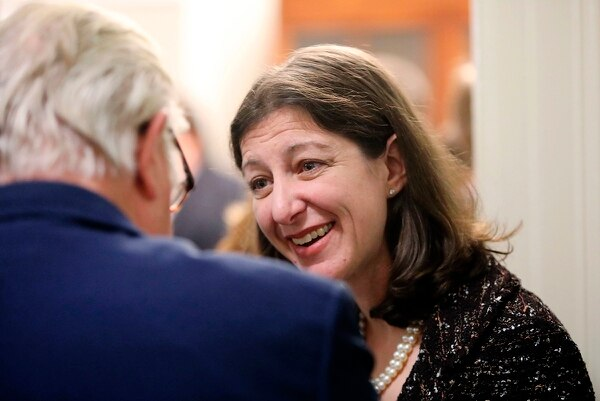 Elaine Luria, a Democratic representative from Virginia's 2nd Congressional District, greets guests at a reception before she is sworn in to Congress, on Jan. in Washington. The former Navy commander defeated Republican Scott Taylor, a Navy SEAL veteran, to take over his seat. (Steve Earley/The Virginian-Pilot via AP)
