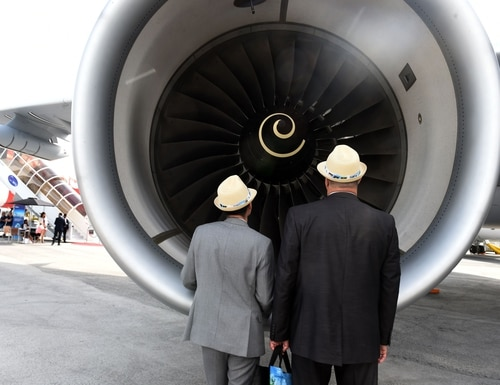 Visitors look at the engine of an Airbus A330 MRTT multirole tanker aircraft while visiting the Airbus static display at the International Paris Air Show on June 18, 2019, at Le Bourget Airport, near Paris. (Photo credit should read Eric Piermont/AFP via Getty Images)