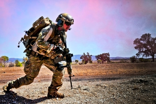 A pararescueman from the 129th Rescue Wing, Moffett Federal Airfield Calif., conducts tactical field training in October 2014. The Senate passed its draft of the annual defense authorization bill this week, leaving a host of pay and equipment questions to be reconciled by lawmakers in coming weeks. (Senior Airman Rachael Kane/California Air National Guard)