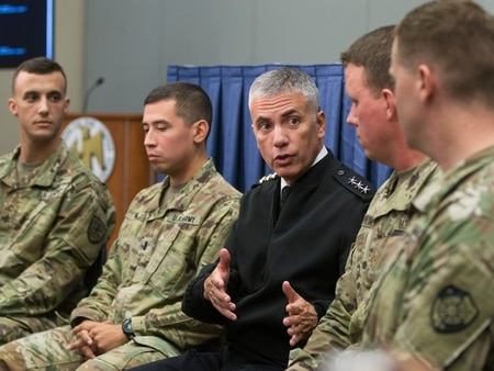 Cyber operators join Lt. Gen. Paul Nakasone, commanding general of Army Cyber Command, center, to talk about cyber protection teams and missions at the AUSA annual meeting in Washington, D.C. on Wednesday. (Mike Morones)